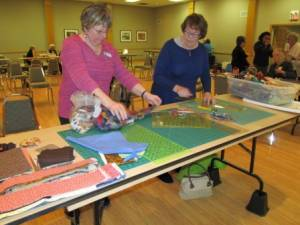 Cutting fabric for Community Projects at Feb meeting