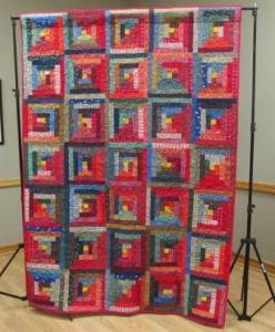 Red log cabin shown at April meeting by Penny
