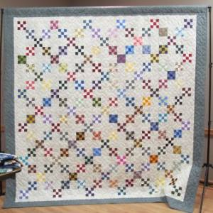 Penny's quilt using squares from last year's Niners Club