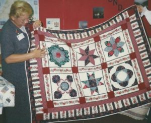 Anita Hardison and the class quilt